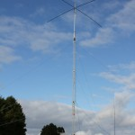 The antennas at G9V, 5-band Spiderbeam on the tower and the 40m vertical behind it.